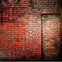 Filled in derelict door with red brickwork