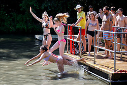 © Licensed to London News Pictures. 07/05/2018. London, UK. Lara Mckenzie and Jenna Vivers swim in Hampstead Heath Mixed Bathing Pond in north London as temperatures hit 28C on the hottest May bank holiday since 1999 on Monday, May 7, 2018. Photo credit: Tolga Akmen/LNP
