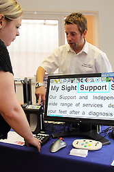 Demonstration of adapted computer featuring enlarged print and icons at the Mysight charity for people with visual impairments.