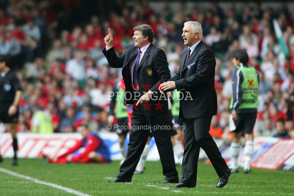CARDIFF, WALES - SATURDAY MARCH 26th 2005: Wales' manager John Toshack and Austria's coach Hans Krankl during the Wold Cup Qualifying match at the Millennium Stadium. (Pic by David Rawcliffe/Propaganda)
