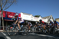 (Geelong, Australia---2 October 2010) USA rider Theresa Cliff-Ryan takes on water at the head of the peloton as it travels past the cafes of Geelong's Packington Street during the Elite Women's Road Race at the 2010 UCI World Championships. The Canadian rider in the background is Anne Samplonius. [2010 Copyright Sean Burges / Mundo Sport Images -- www.mundosportimages.com]