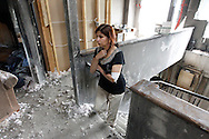 TREVOR HAGAN - Kiran Bangal walks up the stairs of her dream home that was totally destroyed last Friday during a fire.<br /> July 15, 2010