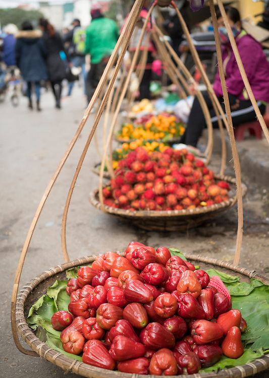 Asia, Vietnam, Hanoi, old quarter. A variety of fruits and vegetables for sale.