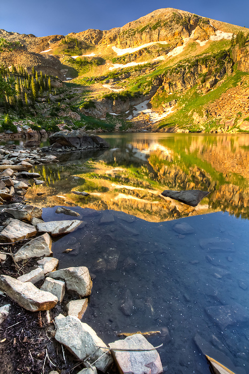 The shoreline of Cecret Lake in Utah at sunrise.