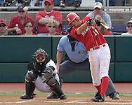 Nebraska's Ryan Wehrle drives the the ball up the middle for a base hit against Kansas State.  Nebraska held on to be Kansas State 5-4 at Tointon Stadium in Manhattan, Kansas, April 1, 2006.