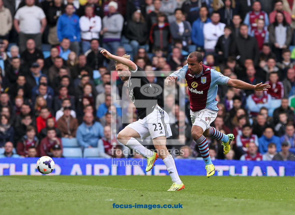Gabriel Agbonlahor (right) of Aston Villa and Luke Shaw (left) of Southampton battle for the ball during the Barclays Premier League match at Villa Park, Birmingham<br /> Picture by Tom Smith/Focus Images Ltd 07545141164<br /> 19/04/2014