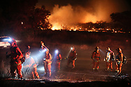 Firefighters battle the Lilac fire in Bonsall, California on Thursday, December 7, 2017.  The fire has burned approximately 3000 acres and over 1000 homes had to evacuate.