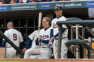 Joe Mauer #7 and Justin Morneau #33 of the Minnesota Twins looks on during a game against the Detroit Tigers on April 3, 2013 at Target Field in Minneapolis, Minnesota.  The Twins defeated the Tigers 3 to 2.  Photo: Ben Krause