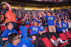 Teens reaching to catch free t-shirt at We Day 2015, Seattle, Washington. Free the Chldren event which inspires youth activism and volunteering.