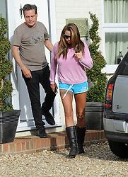 Katie Price is Escorted to an awaiting vehicle by Derrick Pountney at the home of Jane Pountney, Pulborough,West Sussex, UK, Wednesday, 7th May 2014. Picture by i-Images