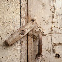 White-washed barn board with old door latch hardware.