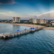 Pompano Pier at sunrise with flags Drone photography