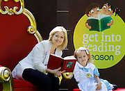 No Fee for Repro: 26/07/2012.'Alice' Kayla Cooke aged 5 from Drumcondra, Dublin and 'Rabbit' Brandon Best-Blake aged 5 from Clondalkin, pictured with leading Irish author Cathy Kelly who pledged her support for the Eason 'Get Into Reading' campaign which aims to highlight the importance of reading, especially with young children. Eason commissioned research into the nation's reading habits which revealed almost one in five (18%) Irish parents never read to their children. Eason is asking the Irish public to pledge their support at Easons.com/getintoreading. Pic Andres Poveda CPR.
