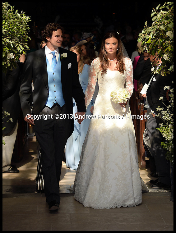 Lady Natasha Rufus Isaacs with her new husband  Rupert Finch, after their wedding at<br /> The Church of St.John the Baptist, Cirencester, United Kingdom<br /> Saturday, 8th June 2013<br /> Picture by Andrew Parsons / i-Images
