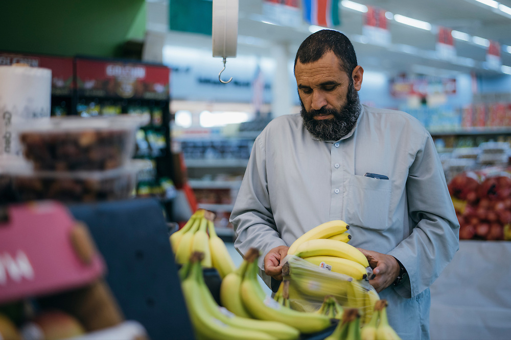 Gulab buys bananas at the grocery store in Arlington, Texas on May 6, 2016. With respect to his religion, Gulab travels over 30 minutes to the closest store that caters to the muslim population