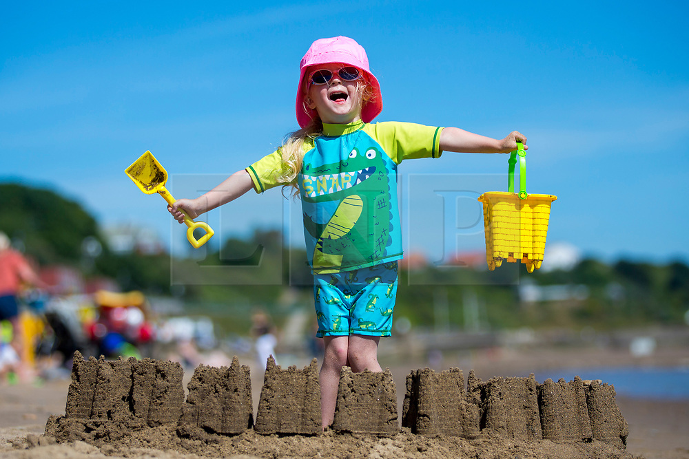© Licensed to London News Pictures. 25/06/2018. Scarborough UK. Three year old Scarlet plays on Scarborough beach this morning as temperatures are set to hot 29c this week. Photo credit: Andrew McCaren/LNP