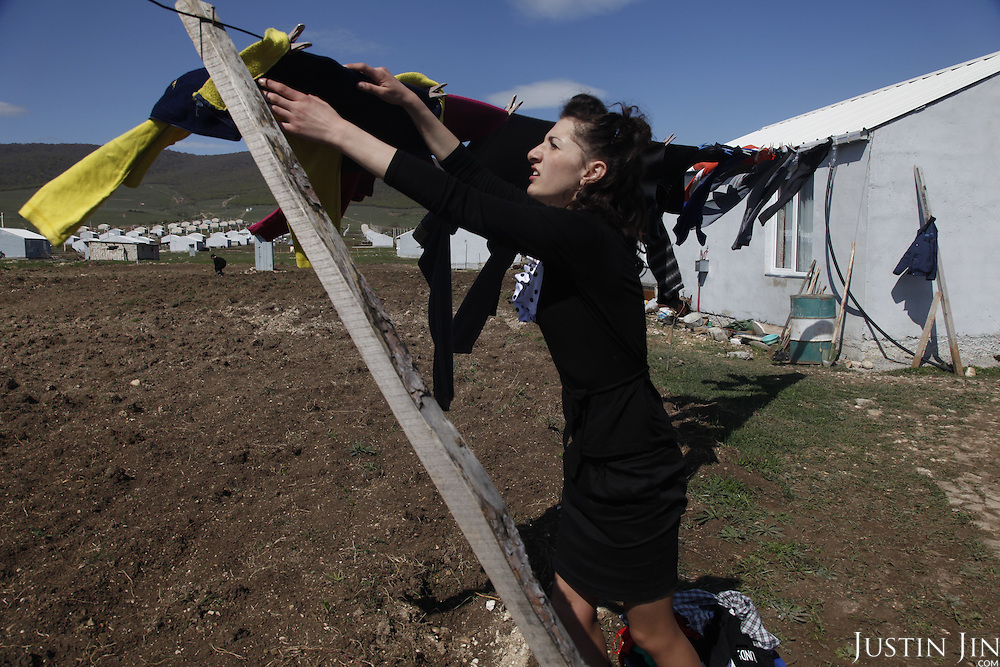 Bella, an IDP (internally displaced person)  hangs her wash at a camp outside Tblisi, Georgia. The camp was set up after the war with Russia in August 2008. Georgia, a former Soviet country, has been engaged in border conflict with its giant neighbour since the breakup of the Soviet Union in the early 1990s.