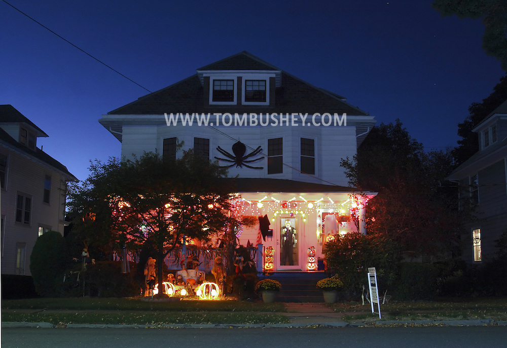 Middletown, N.Y. - A house with Halloween decorations in a suburban neighborhood at twilight on Oct. 21, 2007.