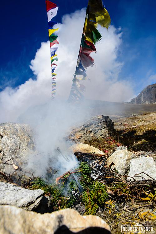 Juniper a natural incence is burned below preyer flags, above the village of Machermo, Sagarmatha National Park, Nepal.