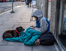 FILE IMAGE © Licensed to London News Pictures. 22/10/2019. London, UK. A homeless man comforts his dog in Tothill Street. Pictures highlight the reality of homelessness in Westminster taken during the build up of Brexit and the General election just a few hundreds yards from Parliament and Downing Street. Photo credit: Alex Lentati/LNP