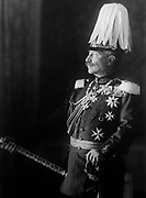 Wilhelm II (1859-1941) German Emperor (Kaiser)1888-1918. Three-quarter length portrait standing in military uniform  facing left, with plumed helmet and holding a Field Marshal's baton.