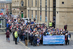 © Licensed to London News Pictures. 27/02/2016. Huddersfield, UK. Thousands of protesters march through Huddersfield in West Yorkshire as they fight to save the town's accident and emergency unit. The march is in reaction to the news that the NHS wants to scrap the A&E unit at Huddersfield Royal Infirmary in order to cut costs.  This protest comes in the same week that junior doctors announced six new days of strikes and a legal challenge against Jeremy Hunt's vow to impose their 7-day contracts. Photo credit : Ian Hinchliffe/LNP