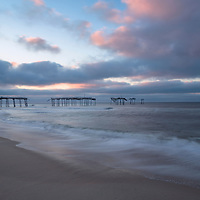 Beautiful clouds and reflections during sunrise at Frisco Pier, Cape Hatteras National Seashore, NC