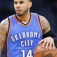 21 December 2015: Oklahoma City Thunder guard D.J. Augustin (14) brings the ball up court during the Oklahoma City Thunder 100-99 victory over the Los Angeles Clippers, at the Staples Center, Los Angeles, California, USA.