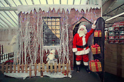A comical feature showing the diverse and wide variety of Santa Clause's one can find in and around London. Father Christmas seems to have a wide range of appearances and different types of grottos from the elaborate Hamley's Toy Store to a garden shed in a Chobham garden centre. <br /> Pictured - Santa Clause and his grotto at Squires Garden Centre, Windsor.<br /> Credit: Rick Findler / Story Picture Agency