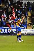 Heads up - Jacob Murphy of Coventry City FC (on loan from Norwich City) fully committed to winning his header during the Sky Bet League 1 match between Shrewsbury Town and Coventry City at Greenhous Meadow, Shrewsbury, England on 8 March 2016. Photo by Mike Sheridan.