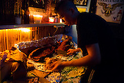 October  2013 - New York, NY. -  Otto's Shrunken Head. Steve Pang cuts a roasted pig during Otto's 11th Anniversary.- Photograph by Jeanette D. Moses/CUNY Journalism Photo