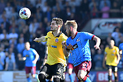 Bolton Wanderers defender Dorian Dervite (4) and Scunthorpe United striker Paddy Madden (9) during the EFL Sky Bet League 1 match between Scunthorpe United and Bolton Wanderers at Glanford Park, Scunthorpe, England on 8 April 2017. Photo by Ian Lyall.