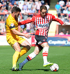Exeter City's Ryan Harley is tackled by Southend United's Gary Deegan - Photo mandatory by-line: Harry Trump/JMP - Mobile: 07966 386802 - 18/04/15 - SPORT - FOOTBALL - Sky Bet League Two - Exeter City v Southend United - St James Park, Exeter, England.