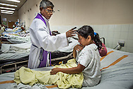 Padre Rejinaldo Garcia blesses patients as he goes throughout the wards of ---hospital on--- day, celebrated today in Santa Rosa de Copan, Honduras, March 5, 2014. Photo Ken Cedeno