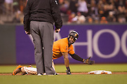 San Francisco Giants center fielder Denard Span (2) reacts to a stumble at second base while trying to take third base on an error against the St. Louis Cardinals at AT&T Park in San Francisco, Calif., on September 16, 2016. (Stan Olszewski/Special to S.F. Examiner)