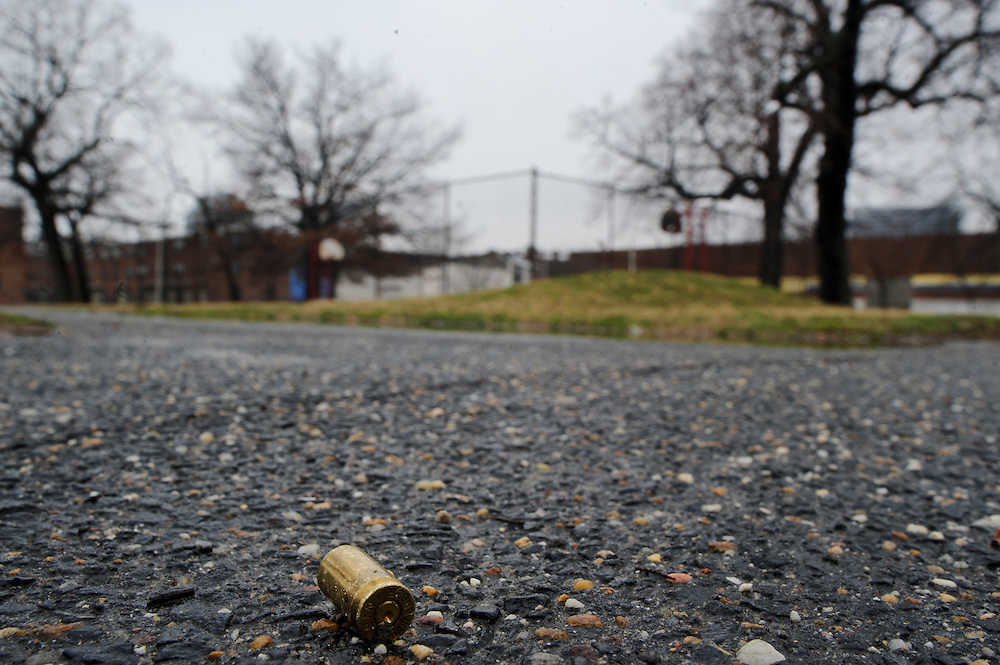 Photo copyright 2009, Matt Roth<br /> Wednesday, February 29, 2012<br /> <br /> A bullet casing was found on City Springs School's playground Wednesday, February 29, 2012. The Southeast neighborhood of Baltimore has a high poverty rate. Ninety-six percent of the student body qualifies for free lunches. Students aren't allowed inside the basketball court, where broken bottles, and used drug paraphernalia are often left, and homeless people are often found sleeping on the school's benches.