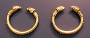 Bracelets, bronze, but encased in gold; Rams head terminals