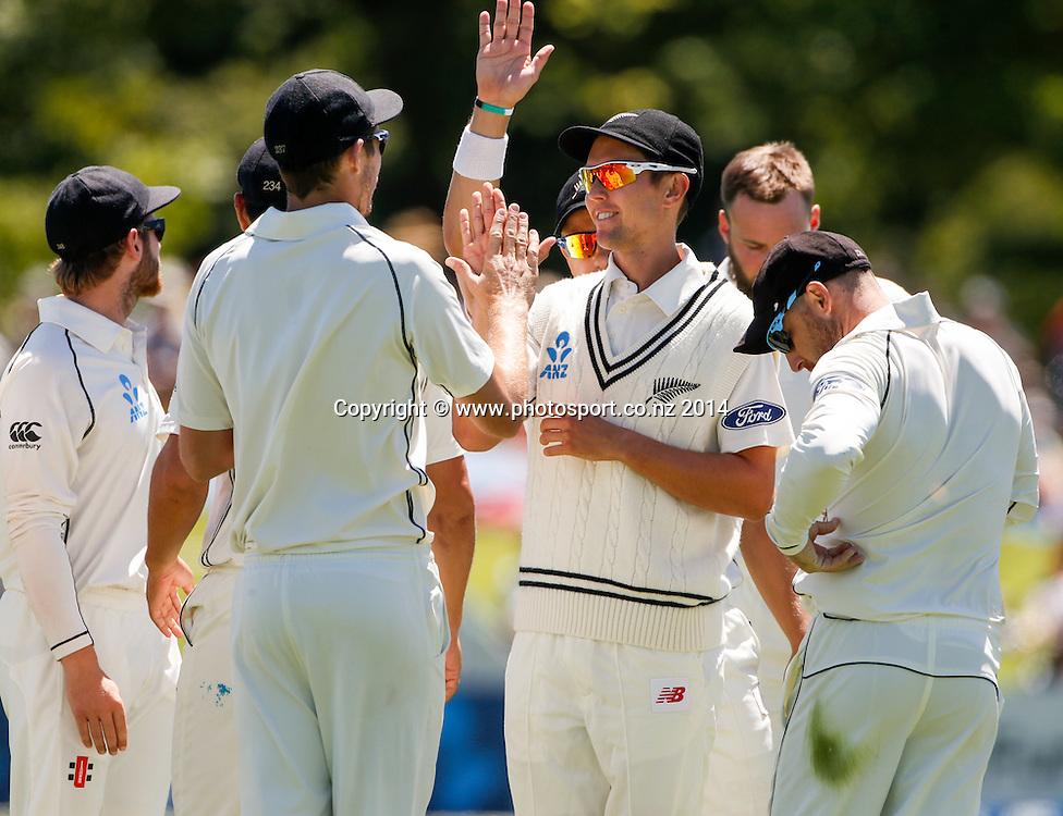 Trent Boult and New Zealand celebrate a wicket. Day 4, ANZ Boxing Day Cricket Test, New Zealand Black Caps v Sri Lanka, 29 December 2014, Hagley Oval, Christchurch, New Zealand. Photo: John Cowpland / www.photosport.co.nz