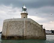 The lighthouse on  Folkestone Harbour Arm. Folkestone, Kent.