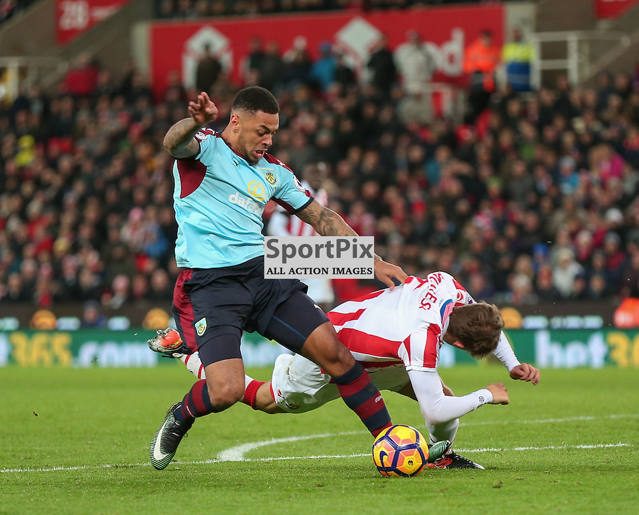STOKE-ON-TRENT, UNITED KINGDOM 03 DECEMBER 2016:  Andre Gray of Burnley is fouled on the edge of the penalty box  during the league game between Stoke City and Burnley at the Britannia Stadium, on December 03, 2016 in Stoke-on-Trent, England. (Photo by Michael Poole)
