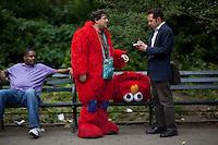 "Bad Elmo ""Luis"" in Central Park. . Photo by Robert Caplin"