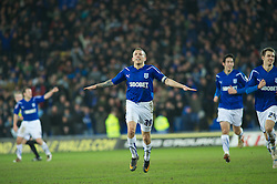 CARDIFF, WALES - Tuesday, February 1, 2011: Cardiff City's Craig Bellamy celebrates scoring from a free kick in the last minute of extra time to draw 2-2 against Reading during the Football League Championship match at the Cardiff City Stadium. (Photo by Gareth Davies/Propaganda)