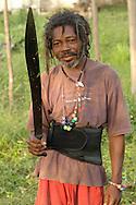 A Garifuna man  a machet takes a break from cleaing a field in Barranco village in southern Belize.