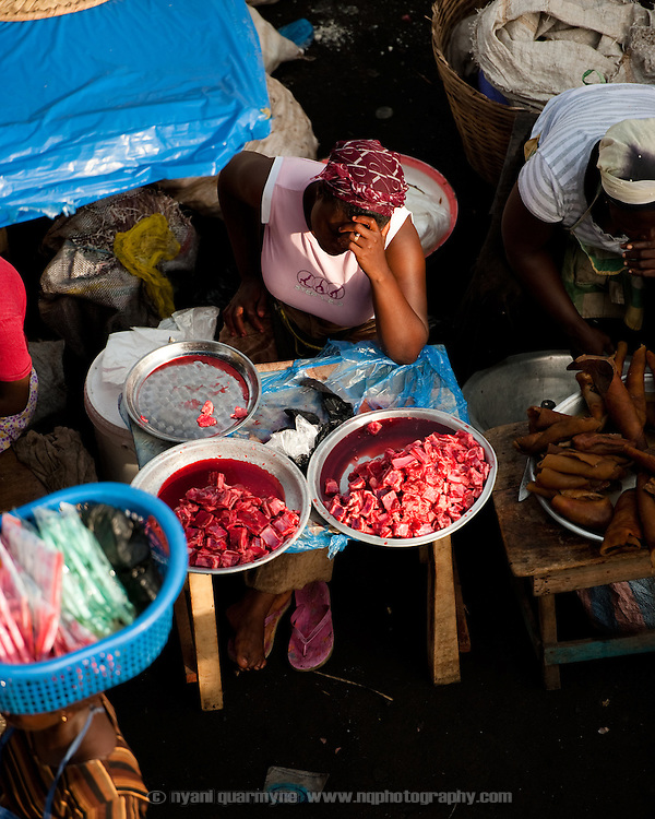 A meat seller in the main thoroughfare of Agbogbloshie, a slum in Ghana's capital, Accra.