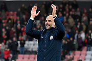 Manchester City manager Pep Guardiola applauds the City fans at full time after a 1-0 win over Bournemouth during the Premier League match between Bournemouth and Manchester City at the Vitality Stadium, Bournemouth, England on 2 March 2019.