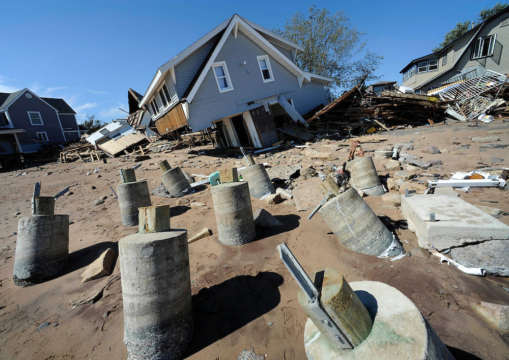 A home destroyed by Tropical Storm Irene rests on the beach in East Haven, Conn., Monday, Aug. 29, 2011. (AP Photo/Jessica Hill)