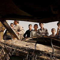 SHEKHAN (Ayn Sifni), NORTHERN IRAQ - April 9: Children are contemplating a burnt out bombed car in  Shekhan. A town of about 30000 inhabitants on the way to Mossul has been taken by Peshmergas. Kurdish Peshmergas and US Special forces are advancing towards  Mossul.   (Photo Patrick Barth/Getty Images)