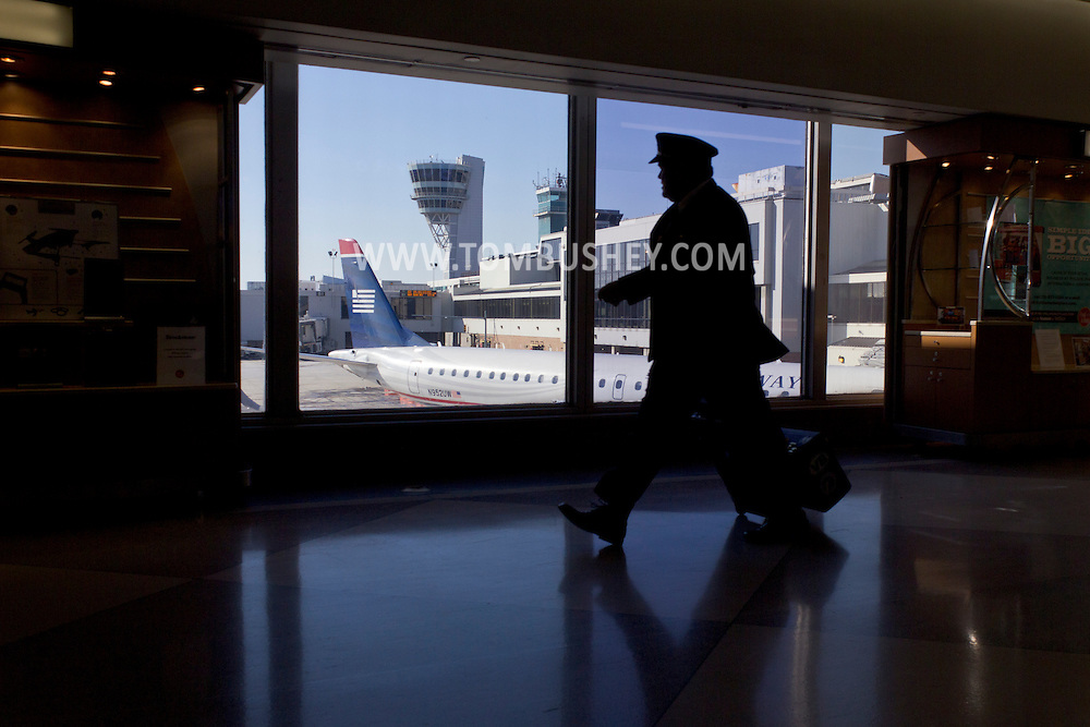 Philadelphia, Pennsylvania - An airline crew member walks past a window at Philadelphia International Airport on Jan. 26, 2013.