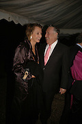 SIR FREDERICK AND LADY FORSYTH, Cartier dinner in the Chelsea Physic Garden. 22 May 2006. ONE TIME USE ONLY - DO NOT ARCHIVE  © Copyright Photograph by Dafydd Jones 66 Stockwell Park Rd. London SW9 0DA Tel 020 7733 0108 www.dafjones.com