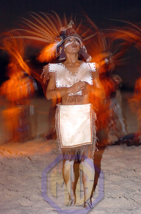 25 December 2004: A Mayan dancer performs on Christmas night on the beach in Playa de Carmen, Mexico on December 25, 2004.